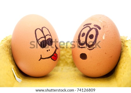 Funny easter eggs with drawn faces depicting various emotions arranged in a cardboard egg carton against white.