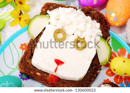 funny easter sandwich with sheep head made from cottage cheese on dark bread as breakfast for child