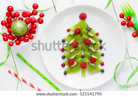 Funny edible Christmas tree, Christmas breakfast idea for kids. Beautiful Christmas and New Year food background #521541790