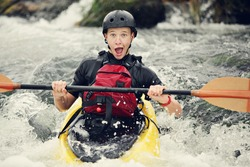 Funny expression on this whitewater kayaker.