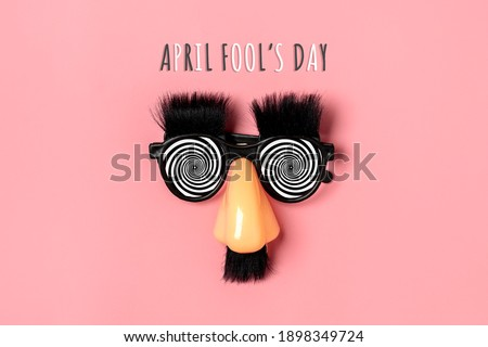 funny face - fake eyeglasses, nose and mustache on pink background Happy fools day  concept  1st April party Holiday card Сток-фото ©