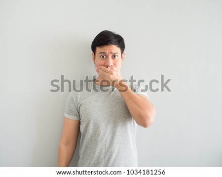 Funny face of bad breath Asian man. #1034181256