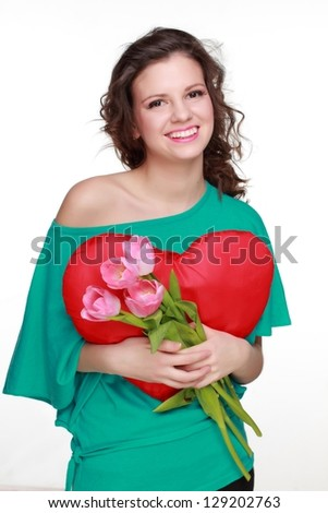 Funny face of teenage girl/Young girl in a bright green jacket with a spring bouquet