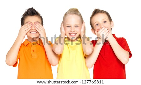 "Funny faces of happy children doing ""See Nothing, Hear Nothing, Say Nothing..."" isolated on white background"