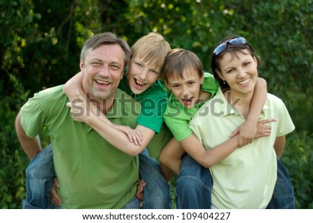 Funny family having fun in the company of each other on the nature