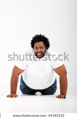 funny fat african man lying on floor
