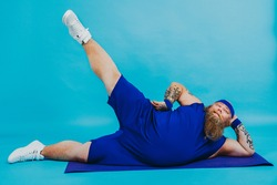 Funny fat man doing some sport exercises - Overweight man having weight issue and tries to start diet and sport, funny character