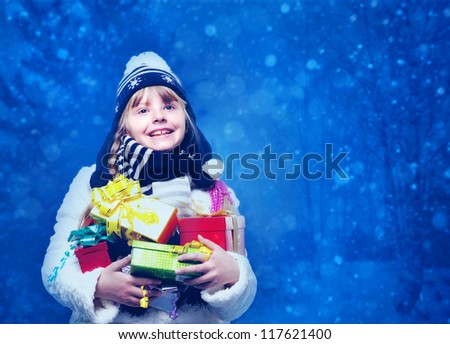 Funny female child with lot of xmas gifts