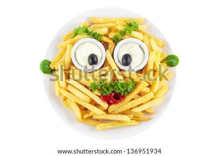 Funny french fries face made of mayonnaise, ketchup, olives and parsley