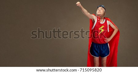 Funny funny cheerful man in a superhero costume in sports clothe