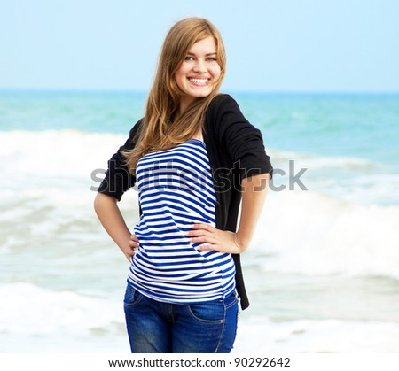 Funny girl at outdoor near sea.