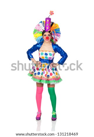 Funny girl clown with a big colorful wig isolated on white background
