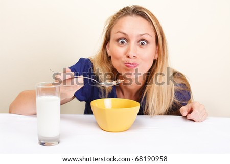 Funny girl eating cereal