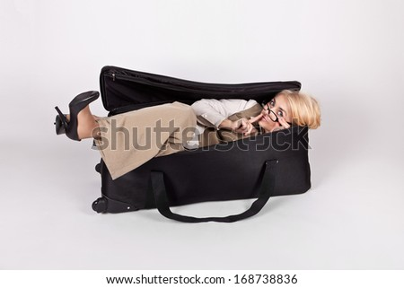 Funny girl in a big bag shows sign of silence