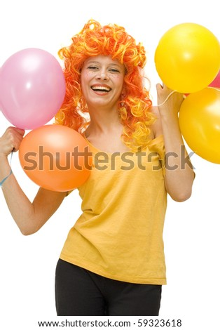 Funny girl in a bright wig laughs