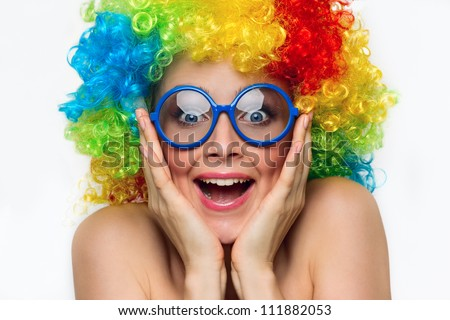 Funny girl in colored wig and blue glasses