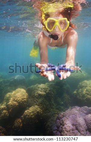 funny girl in scuba mask found blue starfish #113230747