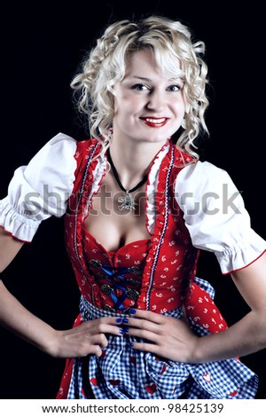 funny girl in typical munich oktoberfest dress on black background