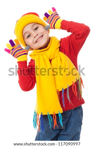 Funny girl in winter clothes, isolated on white