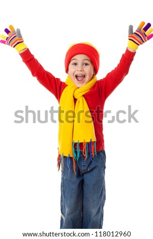Funny girl in winter clothes with greeting sign, isolated on white