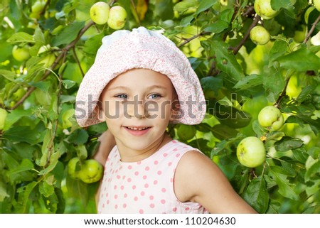 Funny girl next to the apple tree
