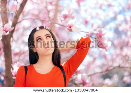 Funny Girl Planning and  Thinking Under Magnolia Tree. Curious introspective woman wondering and counting options