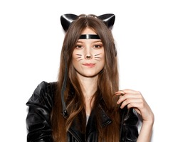 Funny girl represents as small cat.  Woman  with bright makeup hairstyle of girl with leather cat ears having fun. On white background not isolated