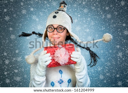 Funny girl with a gift in their hands