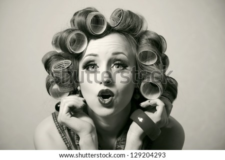 funny girl with hair curlers on ...