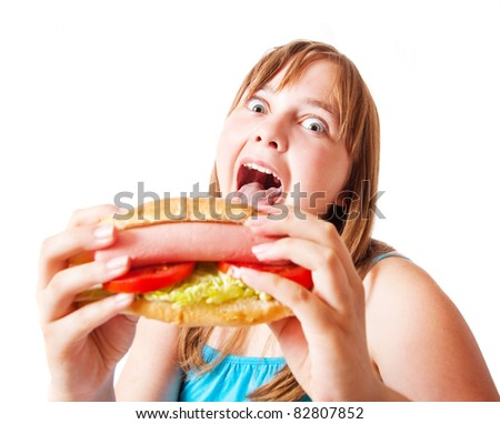 funny girl with hot dog - stock photo