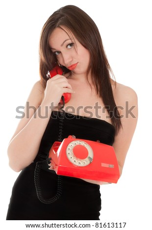 Funny girl with old red telephone talking isolated on white