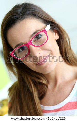 Funny girl with pink eyeglasses