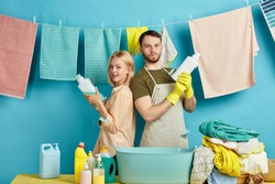 funny good looking man and woman are going to kill dust, mud, spot stains in clothes, housework ,