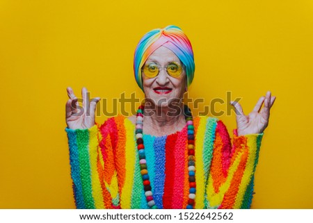 Funny grandmother portraits.granny fashion model on colored backgrounds