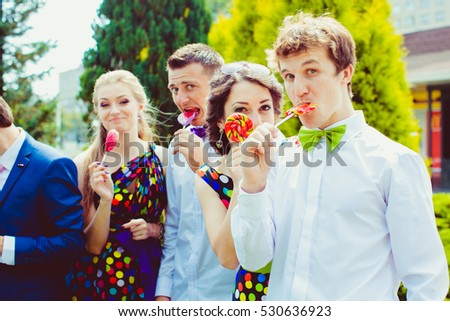 Funny groomsman holds tasty sugar candy in his mouth #530636923