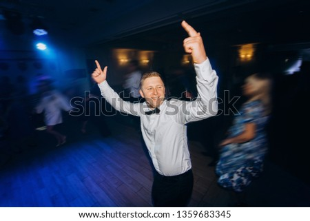 Funny guy dancing at the party. The man dances for dance music. #1359683345