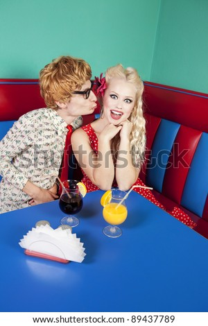 Funny guy kissing a girlfriend, similar available in my portfolio