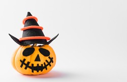 Funny Halloween day party concept ghost pumpkin head jack lantern scary smile wear hat, studio shot isolated on white background, Holiday decoration