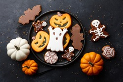 Funny Halloween gingerbread biscuits on black background
