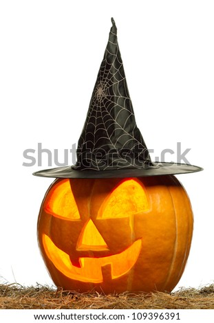 Funny Halloween pumpkin with black hat glowing on white background