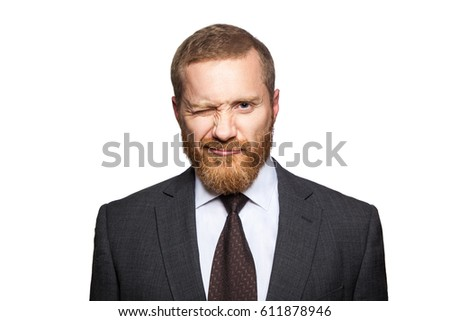 Funny handsome businessman looking at camera and winking. isolated on white, looking at camera.