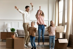 Funny happy family young parents and cute little kids children daughters dancing in living room jump together having fun celebrating moving day relocating in new home renovating apartment with boxes