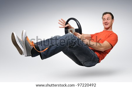 Funny happy man car driver with a wheel, auto concept