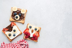 Funny Healthy Breakfast Toasts For Kids Shaped As Cute Animals On Grey Concrete Background With Copy Space For Text. Children's Food Menu For School Lunch Box Or Breakfast At Home. Motherhood Concept