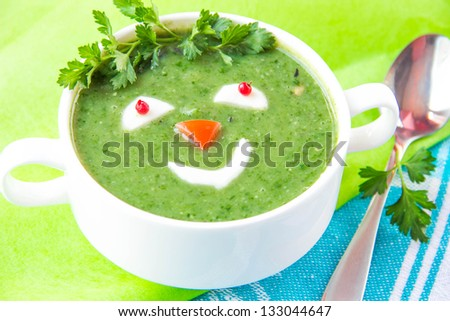 Funny healthy soup with spinach for children