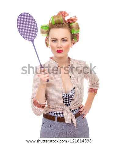 Funny housewife / girl with fly swatter, isolated on white.