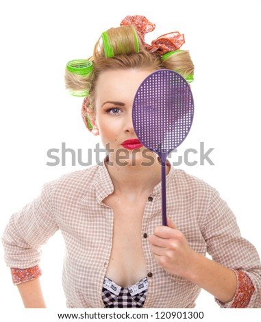 Funny housewife / girl with fly swatter, isolated on white. Close-up