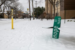 Funny image of a Hope Street sign fallen to the ground during the winter 2021 storm in Dallas Texas