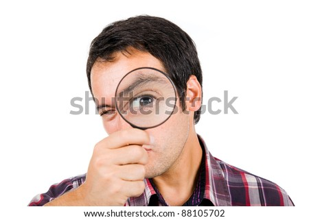 Funny image of a young man playing with a magnifying glass, isolated on white