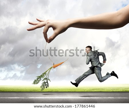 Funny image of businessman chased with carrot Foto d'archivio ©